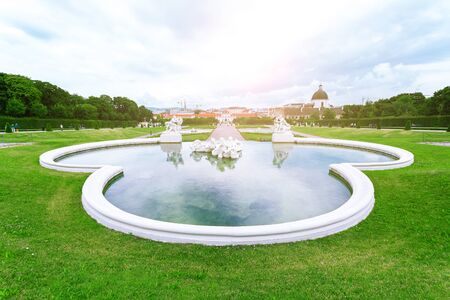 Fountain sculptures in Belvedere Gardens with Lower Belvedere, Vienna, Austria