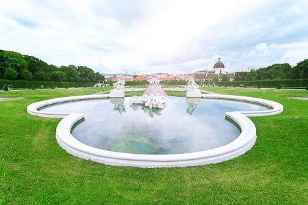 Fountain sculptures in Belvedere Gardens with Lower Belvedere, Vienna, Austria