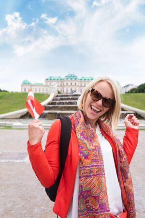 Female traveler against the backdrop of the Upper Belvedere Palace in Vienna.