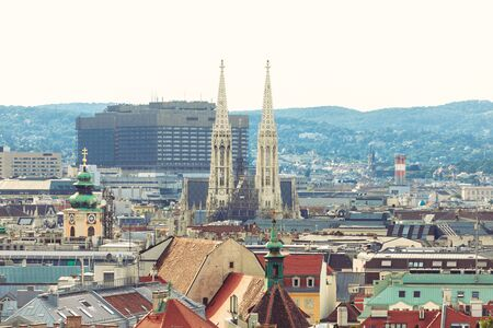 Panoramic view of the city at sunset with the spiers of the Votive Church or Votivkirche in Vienna in the distance. Reklamní fotografie