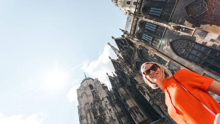 Woman stands on the background of St. Stephens Cathedral in Vienna, Austria Reklamní fotografie