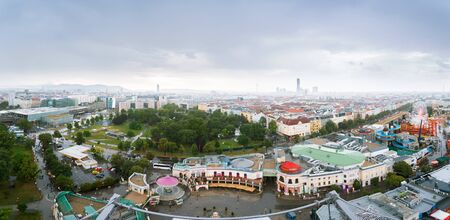 Aerial Vienna city panorama from Vienna Ferris wheel in Wurstelprater in rainy weather, Austria. Skyline view