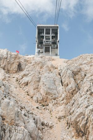 View of the upper station of the cableway to the Tahtali mountain in Kemer from the cab that goes down, Turkey