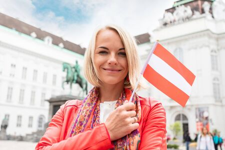 A young girl stands with the flag of Austria Reklamní fotografie