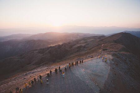 People enjoy the sunset on the observation deck of Tahtali Mountain near Kemer, Aetalia, Turkey Reklamní fotografie