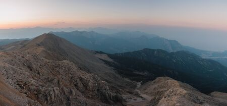 View of the rocky mountains from the top of Tahtali mountain in Turkey at sunset. Stok Fotoğraf