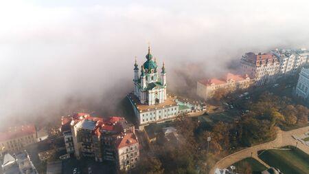 Aerial view of St. Andrews Church in heavy fog, Kiev, Ukraine