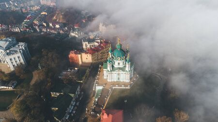 Aerial view of St. Andrews Church and St. Andrews Descent in heavy fog, Kiev, Ukraine