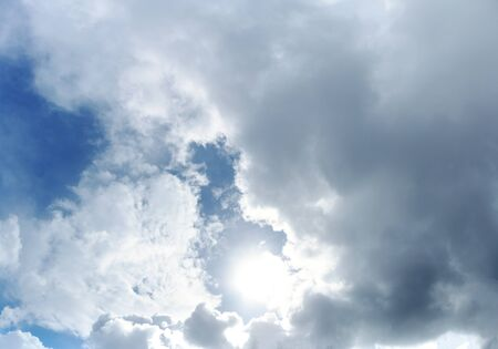 Beautiful panoramic blue sky with white clouds and and backlit suns