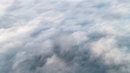 Background made of a large and intense white cloud of smoke or fog. Texture for work, place for text. Imagens