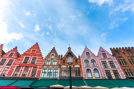 View of the colorful houses in traditional Flemish style on Grote Markt or Market Square in Bruges, Belgium