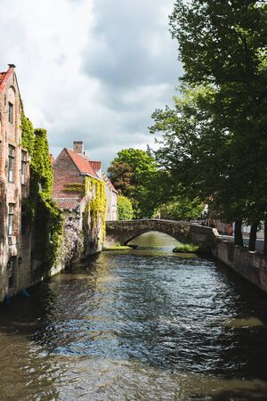 View of one of the many beautiful streets of Bruges, Belgium Foto de archivo - 136320769