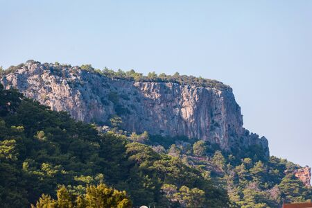 Mountain landscape with a protruding rock on a background of greenery 版權商用圖片