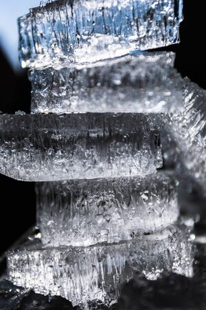 Abstract background with broken pieces of natural ice on a dark background tower lined. Reklamní fotografie
