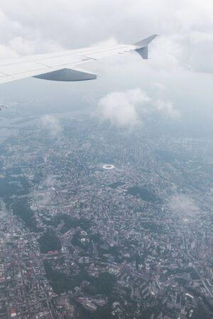 Panoramic view of the city of Kiev from the window of an airplane during a flight, Ukraine