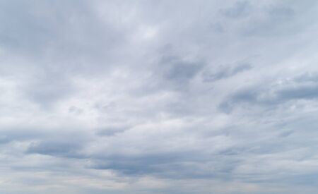Cloudy gray and white sky with thick dense clouds.