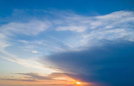 Beautiful sky with sunset sun and beautiful clouds Standard-Bild