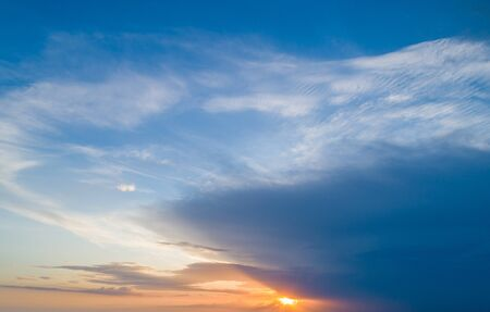 Beautiful sky with sunset sun and beautiful clouds Imagens