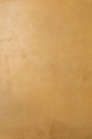 Mustard color microcement texture background
