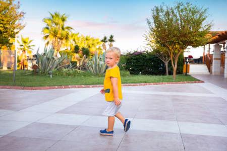 A boy walks through the territory of a luxury hotel