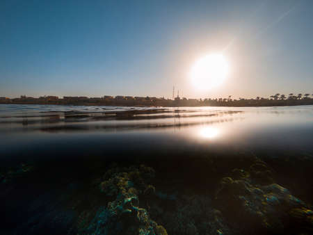 Water surface and coastline at sunset. Banco de Imagens