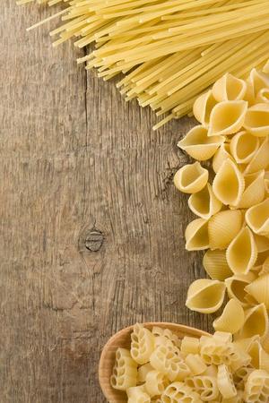 raw pasta on wood background texture Stock Photo