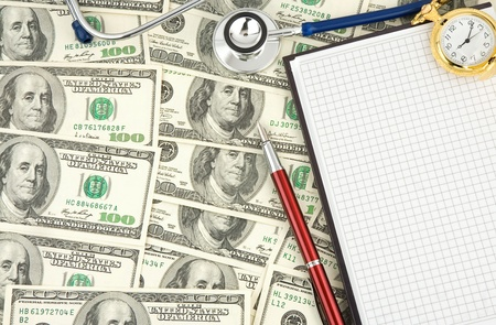 stethoscope and dollars with notebook photo