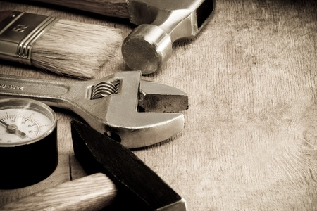 tools and instruments on wood board on sepia photo