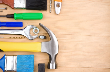 set of tools and instruments on wood board photo