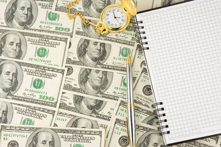 notebook, pen and watch at dollars photo