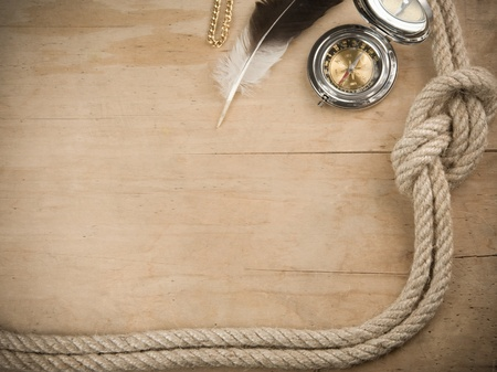 fixed line: ship ropes and compass on wood background board