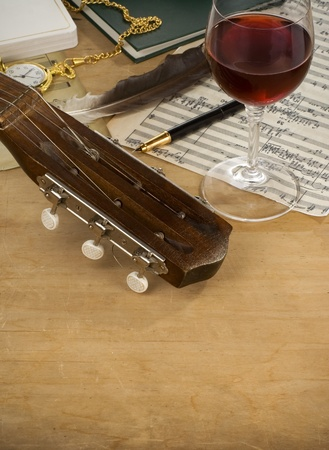 guitar, glass of wine and music note photo