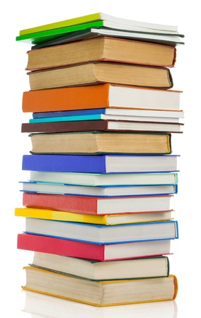 pile of books isolated on white background photo