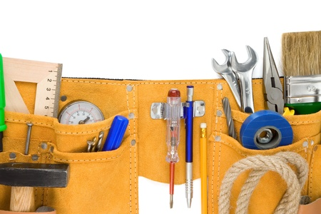 tools in leathern belt isolated on white background photo