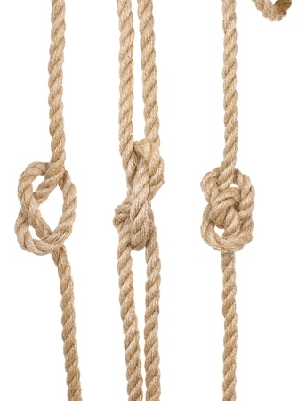 close up ship ropes with a knot isolated on white background photo