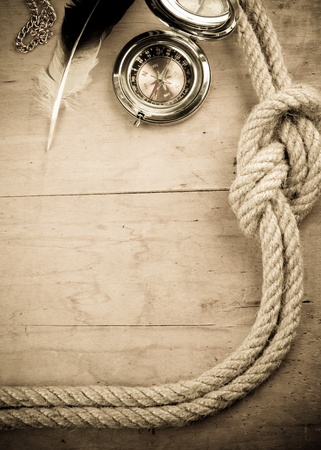 ship ropes and compass on wood background Stock Photo - 11852602