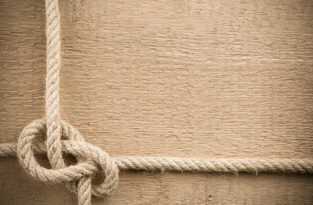 natural rope: ship ropes on wood background texture