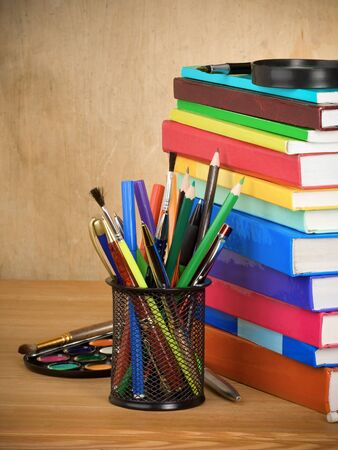 back to school concept and pile of books on wooden table Stock Photo - 11852415