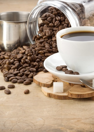 cup of coffee and pot with roasted beans Stock Photo - 11852437