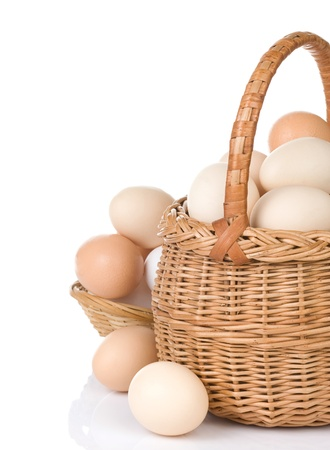 eggs and basket isolated on white background Stock Photo - 11852349