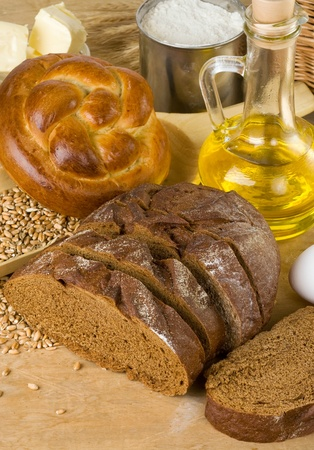 bakery products and grain on wood background photo