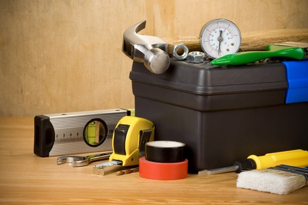 set of tools and toolbox on wood texture photo