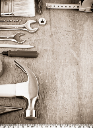 building tool: tools and instruments at wooden board on sepia