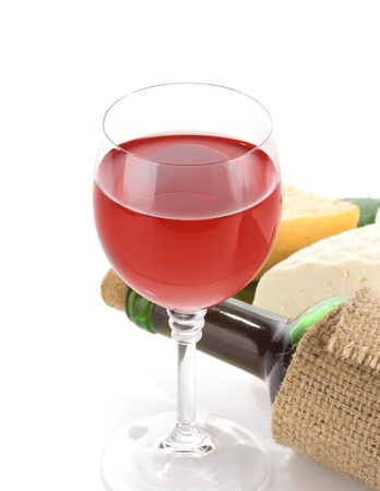 glass of red wine and cheese with reflection  isolated on white background photo