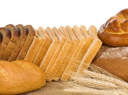 bakery products and wheat with spike isolated on white background photo