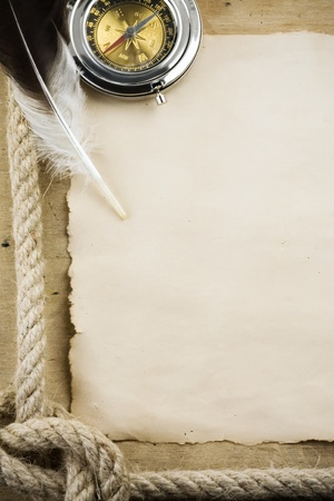 ship ropes and compass on wood background Stock Photo - 11852980