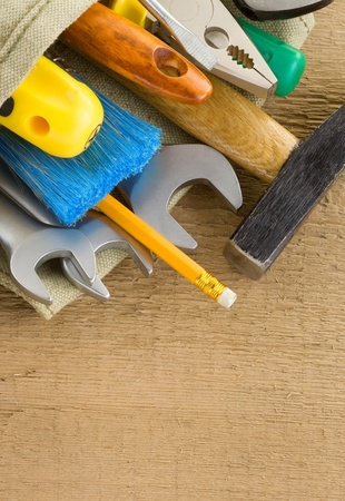 tools construction and bag on wood texture Stock Photo - 11853009
