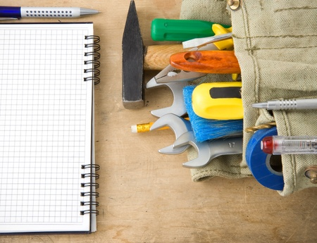 tools and notebook on wood texture Stock Photo - 11852981