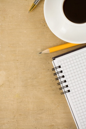 notebook and coffee on wood photo