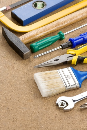 construction tools on wood background photo